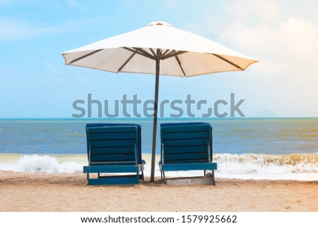 Sun beds chaise lounges against the backdrop of the sea, relaxation.  Beach vacation, tropical vacation.
