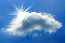 Sun behind a cloud in the blue sky