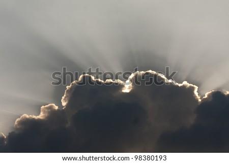 Sun behind cloud - stock photo