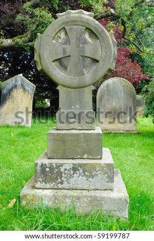 Sun Cross on a grave in the rural country side of North Yorkshire, England.