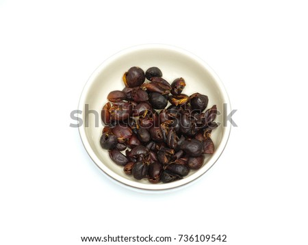 Shutterstock Sun dried coffee cherries (or cascara in Spanish)  in a white ceramic cup ready to be made into herbal tea.