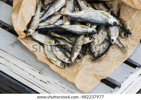 Sun dried fish. Stock-fish on the brown paper.