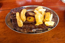 Sun dried meat, milanesa banana and fried macaxeira typical food from northeastern Brazil
