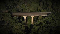 Sun facing side of old sandstone Knapsack Viaduct Bridge, Blue Mountains, NSW, Australia