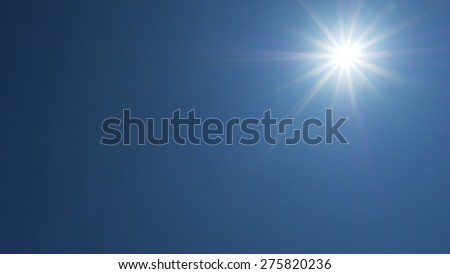 sun flare of 12mm lens on blue sky background in the afternoon #275820236