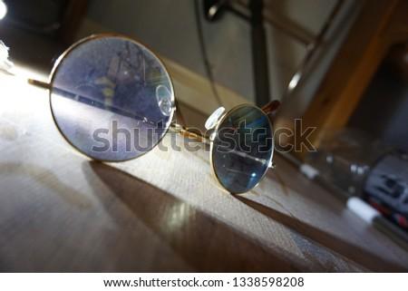 Sun glasses on dusty surroundings #1338598208