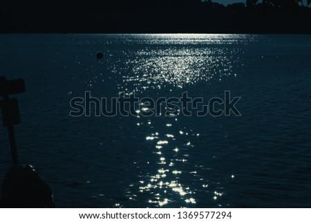 sun glistening on lake