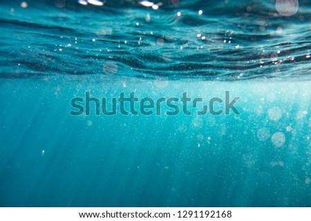 Sun glistening through water
