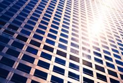 sun glow between the windows of the skyscraper