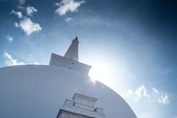 Sun halo over Ruwanweli Maha Seya or Mahathupa is a hemispherical stupa containing relics in Anuradhapura, Sri Lanka