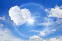 Sun halo with heart cloud on the blue sky, Cloud shaped heart on blue sky white cloud background.