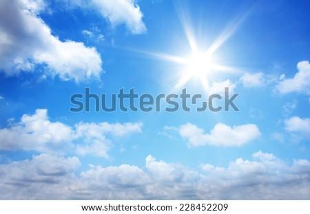 Sun in blue sky.  - Shutterstock ID 228452209