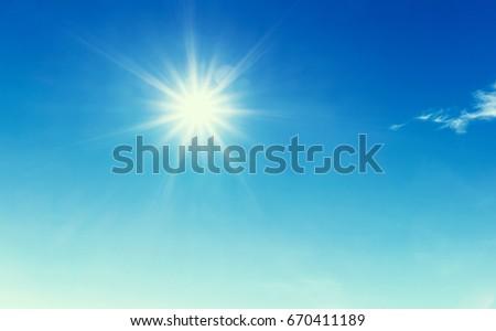 Sun in blue sky. - Shutterstock ID 670411189