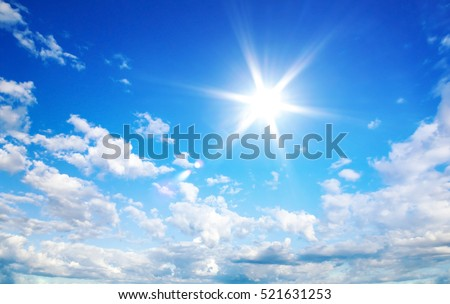 Sun in blue sky with cloud #521631253