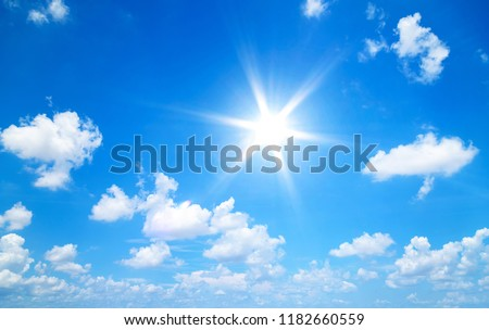 Sun in blue sky with clouds #1182660559