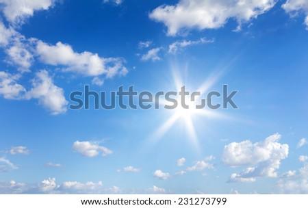 Sun in blue sky with clouds - Shutterstock ID 231273799