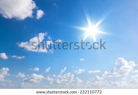 Sun in blue sky with clouds - Shutterstock ID 232110772