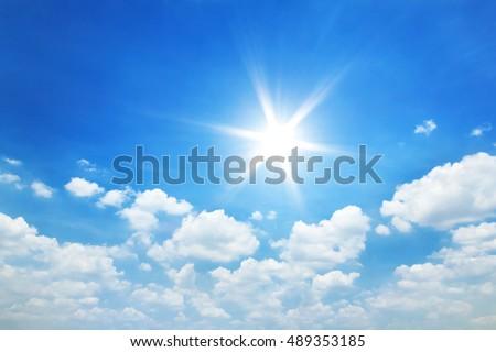 Sun in blue sky with clouds - Shutterstock ID 489353185