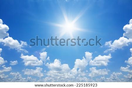 Sun in bright blue sky. - Shutterstock ID 225185923