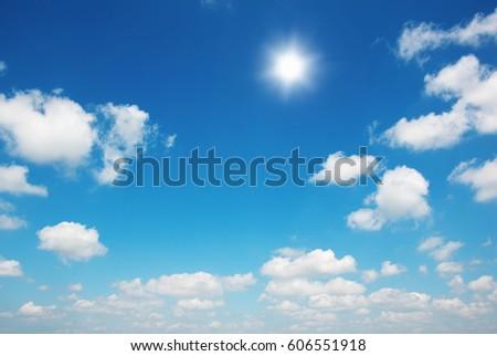 Sun in bright blue sky. #606551918