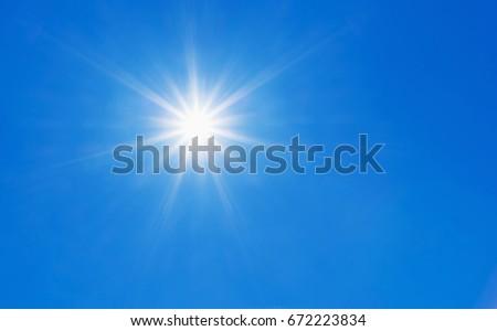 Sun in clear blue sky. #672223834