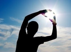 Sun in hands. Element of design.