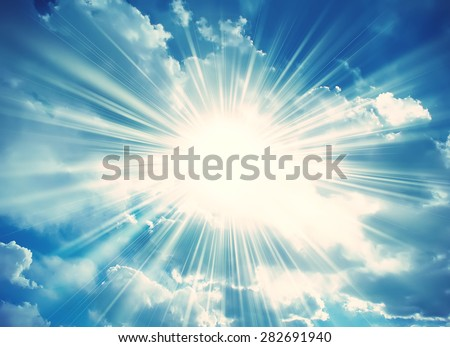 Sun in the blue sky with clouds. Brightly sunlight. Sunny day. Freedom solar concept