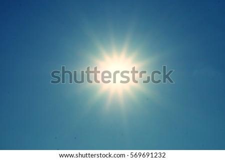 sun in the evening on clear blue sky - Shutterstock ID 569691232