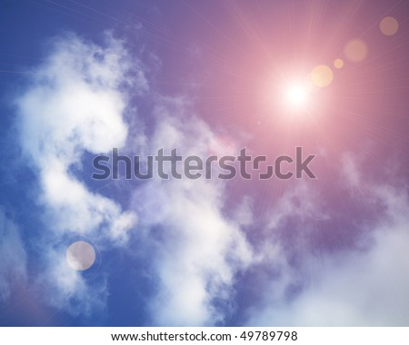 Sun in the sky covered with clouds a lot of copy space. Blue sky with clouds and sun. Sunny sky background in vintage retro style with sun flare. Strong sun and skies