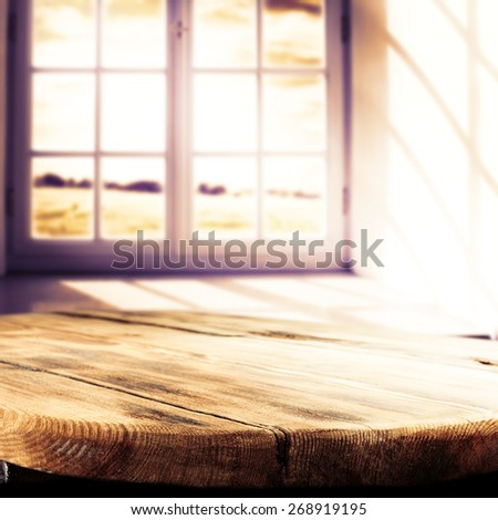 sun light in window and wooden big table of wood