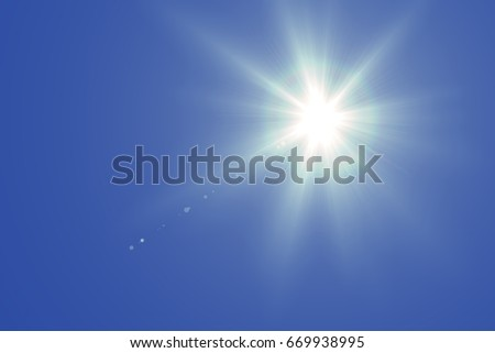sun light with  flare on blue sky background - Shutterstock ID 669938995