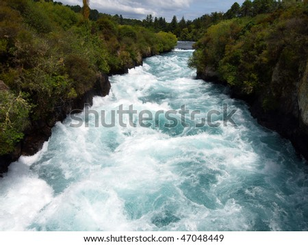 Sun lighting up a section of white water. Huka Falls New Zealand