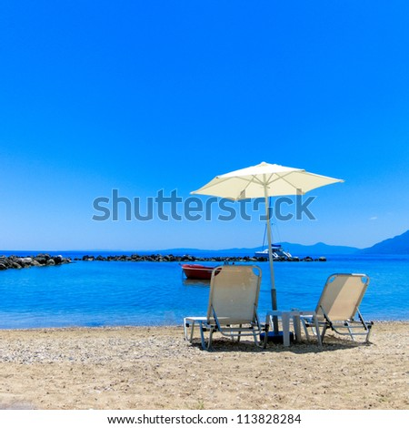 Sun Lounger and Parasol on a Beach