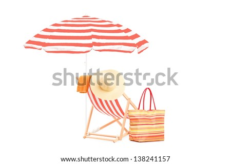 Sun lounger with orange stripes, umrella and summer accessories, isolated on white background