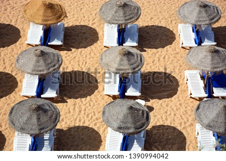 Sun loungers and parasols on the beach seen from above, Albufeira, Portugal, Europe. #1390994042