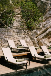 Sun loungers by the swimming pool at the foot of the mountain.