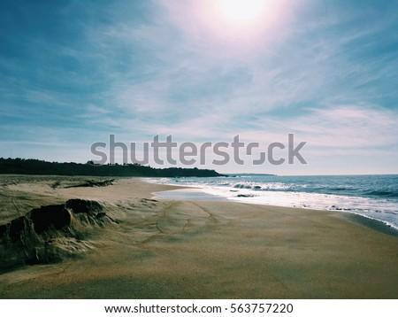 sun, nobody, deserted beach and the Pacific Ocean (Puerto Escondido, Mexico) #563757220