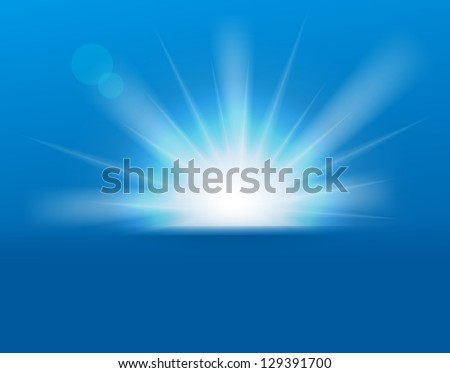 Sun on blue background with copy space.