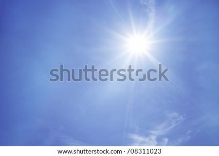 Sun on blue sky - Shutterstock ID 708311023