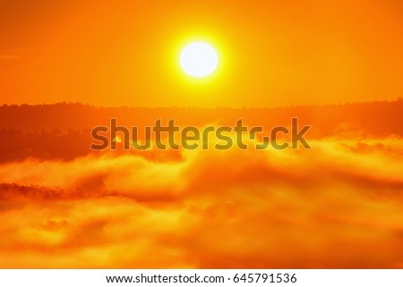 sun over mountain mist on sunrise,orange white balance - Shutterstock ID 645791536
