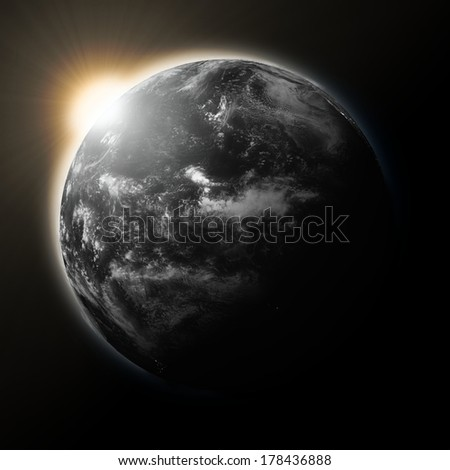 Sun over Pacific Ocean on dark planet Earth isolated on black background. Elements of this image furnished by NASA.