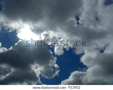 Sun peeking though break in clouds - illustrating hope