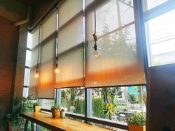 Sun protection curtain in coffee shop.