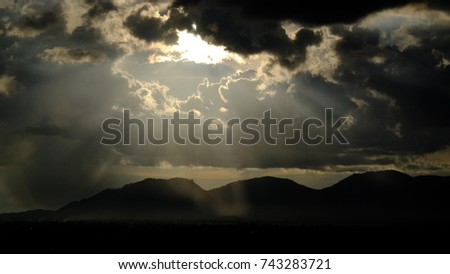Shutterstock Sun ray,crepuscular rays: streaming through gaps in clouds are parallel columns of sunlit air separated by darker cloud shadowed regions.  dust, aerosol scatter the sunlight and mark the ray visible.