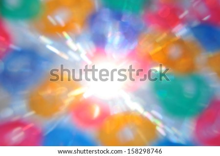 Sun rays and color circles abstract blur. Painted glass lens flare reflections.