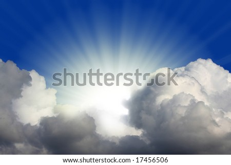 Sun rays behind clouds.