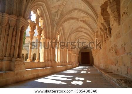 Sun rays enter the cloister of the Royal Abbey of Santa Maria de Poblet (Poblet Monastery) in Catalonia, Spain Сток-фото ©