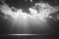 Sun rays in a stormy see landscape
