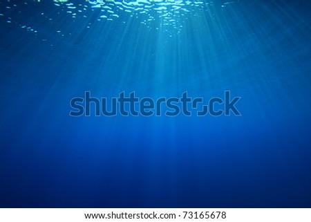 Sun rays in blue ocean