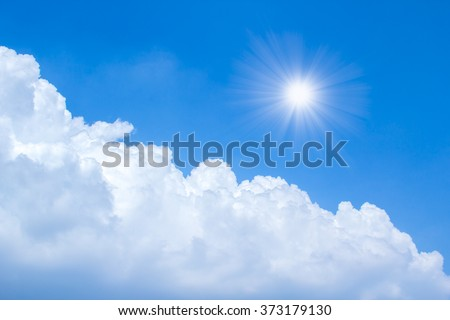 sun rays in bright day with blue sky and clouds  #373179130